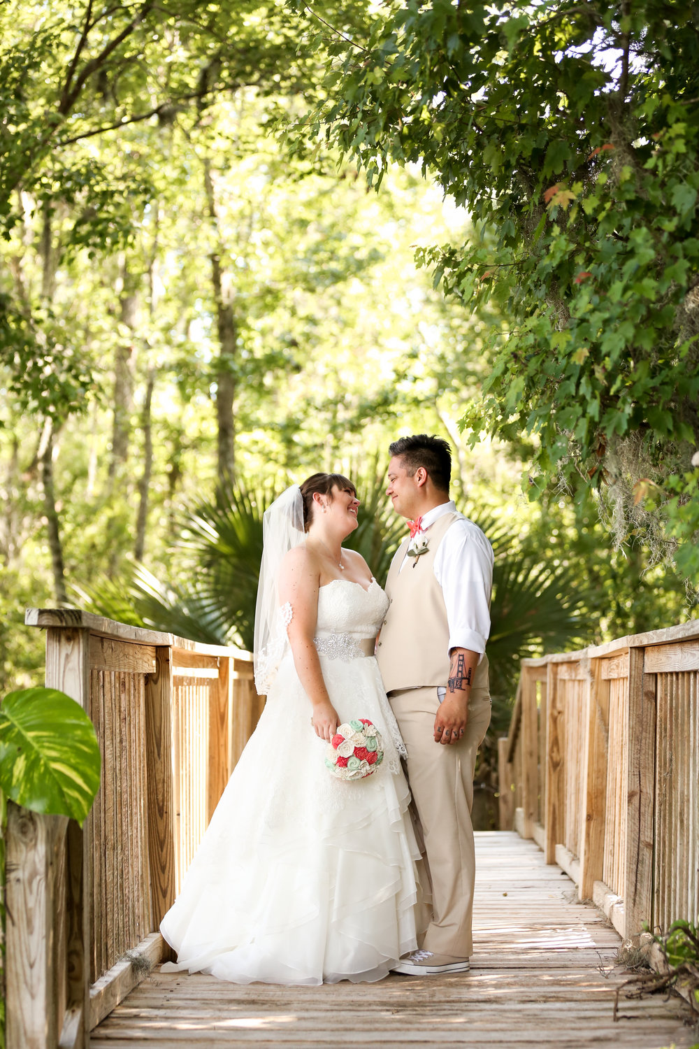 orlando-wedding-photographer-live-happy-studio-bridge-walkway-portrait-bow-tie-couple-mission-inn-resort.jpg