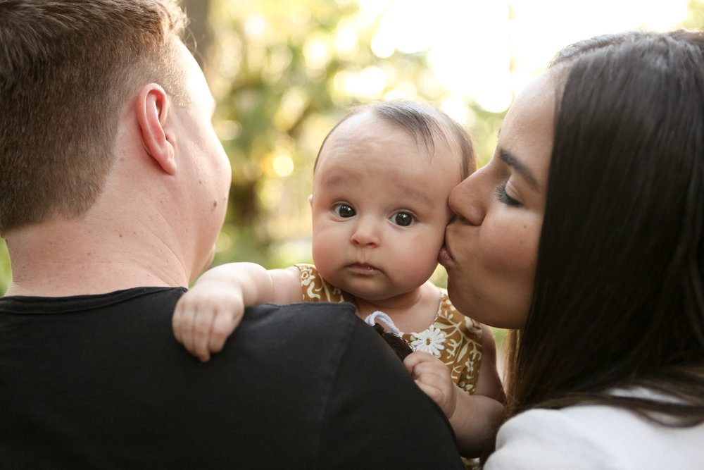 www.livehappystudio.com-family-photographer-orlando-fun-candid-portrait-baby-face-kisses-14.jpg
