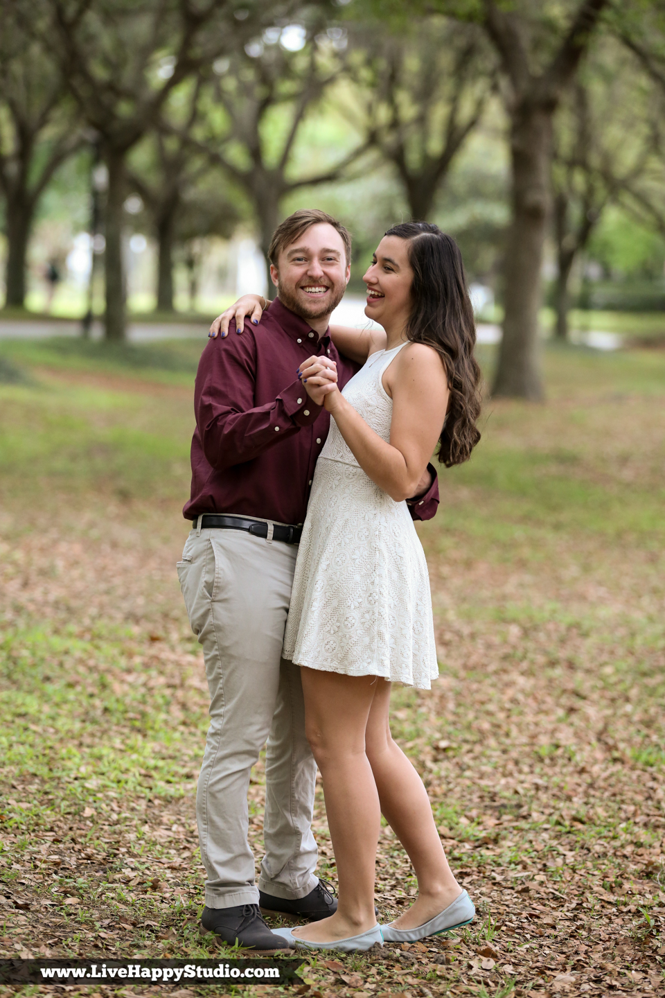 www.livehappystudio.com-cypress-grove-park-orlando-florida-engagement-photographer-candid-road-of-trees25.jpg