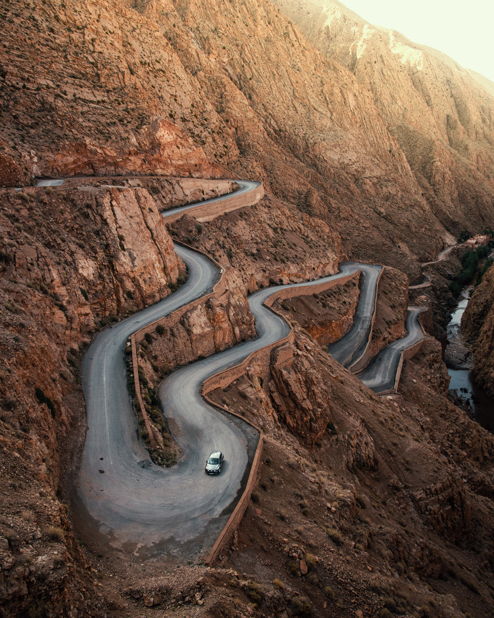 DADES GORGE: A car zig zags to the top of the zenith.