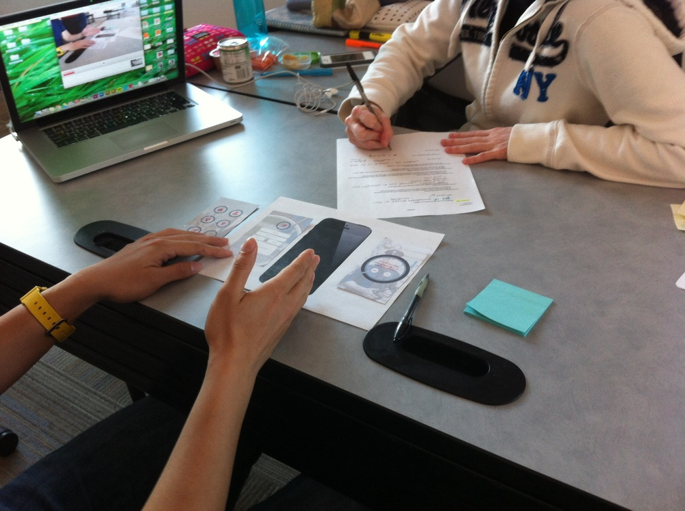 Students conducting evaluation sessions with paper prototypes