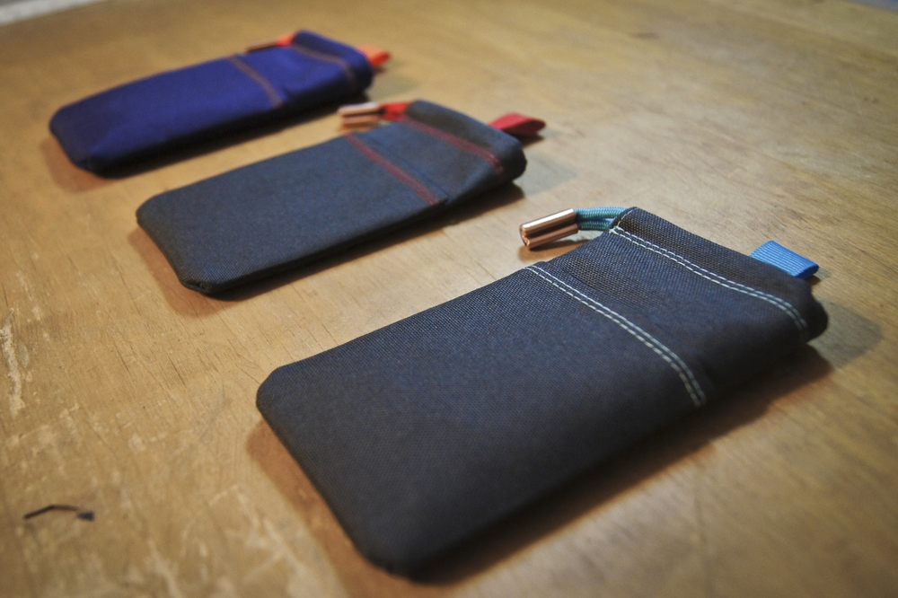 From left to Right: Purple with Orange, Charcoal with Red and Charcoal with Sky Blue