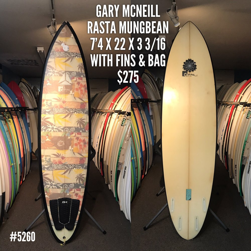 This Gary McNeill 'Rasta Mungbean' quad is a fun quiver addition. It's in good condition with the regular signs of wear and tear. A couple minor repairs and a bit of paint chip by the nose. A great board if you're starting out, or looking for a little extra volume and wave catching ability, without comprimising your maneuverability. This board even comes complete with a set of fins and a board bag for just $275!