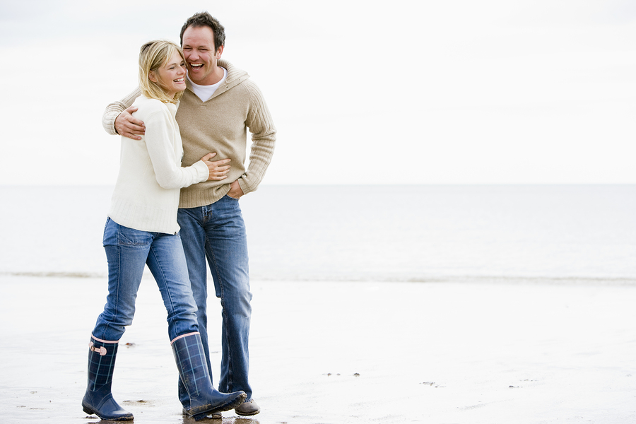 bigstock-Couples-Walking-On-Beach-Arm-I-4135186.jpg