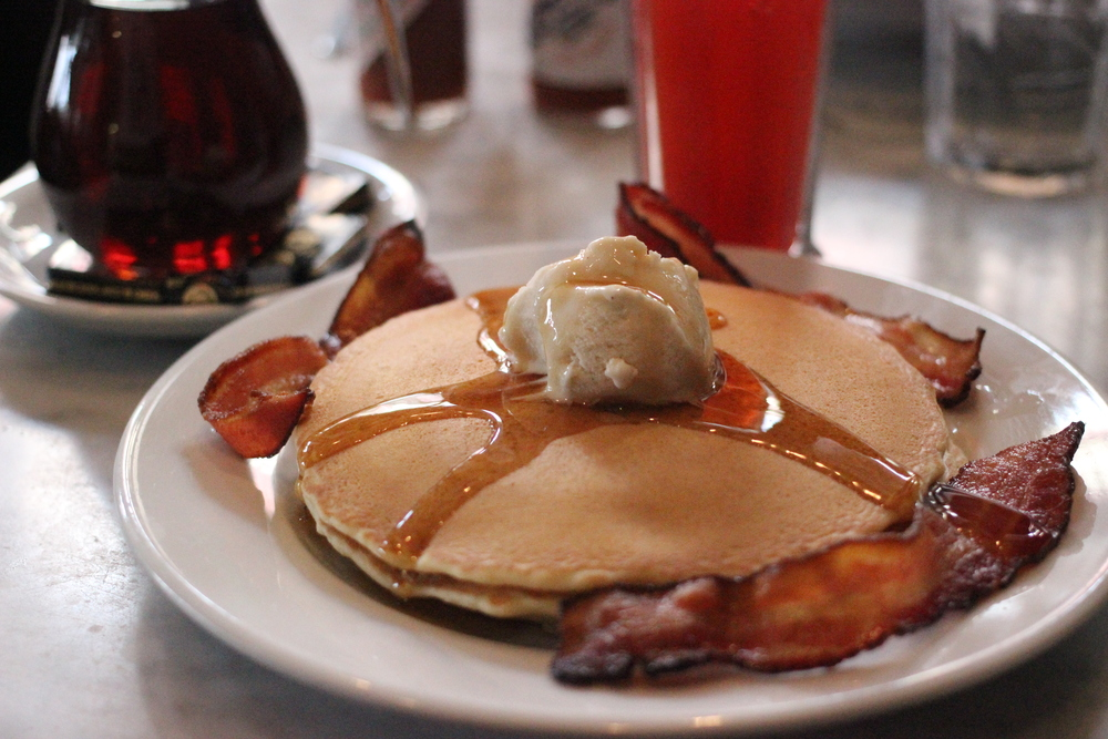 Pancakes, cane syrup, and pecan bacon with a blood orange Italian soda