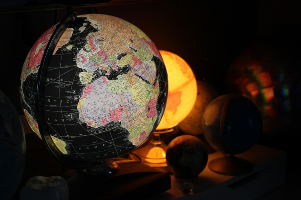 Starlight illuminated globe (and smaller illuminated globe in the background) — the one in focus was slightly damaged but only $25. I just keep the damaged area facing the wall and it doesn't even matter. It gives off such beautiful soft light!