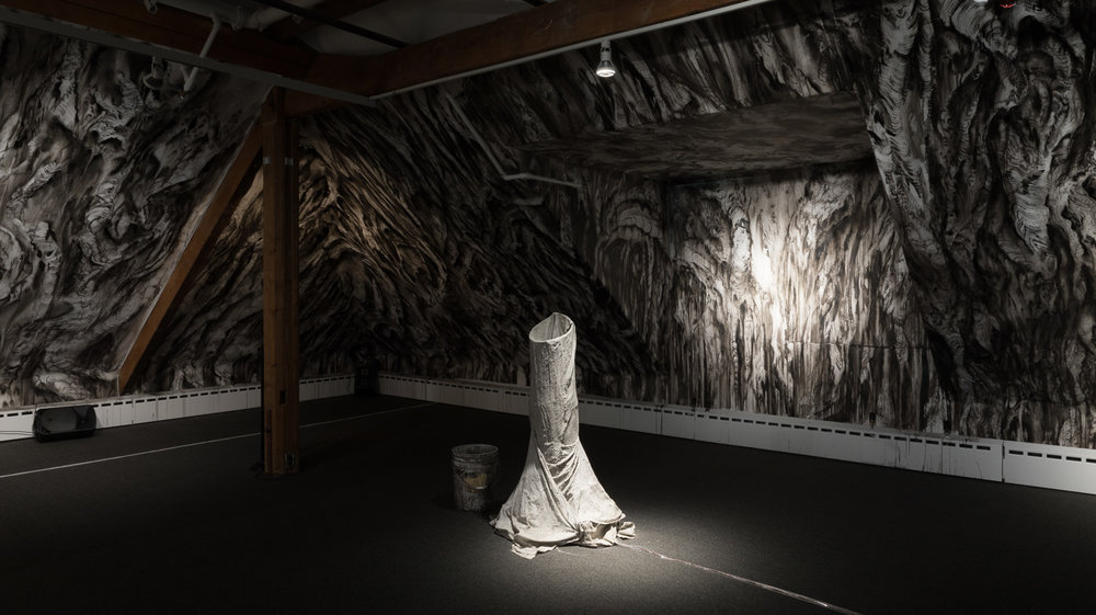 A collaborative drawing by Matt Shane and Jim Holyoak was done on the walls during our residency at Stewart Hall. Nick Kuepfer produced a sound sculpture (stalagmite), projected fire and did amplified the sounds of water dripping in a cave.