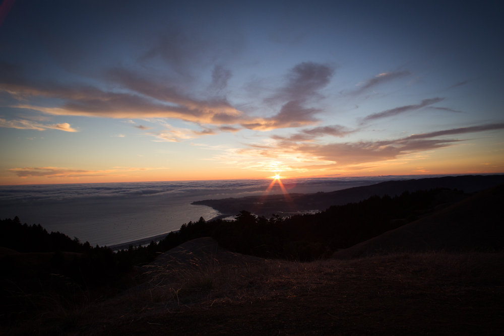 sunset from mount tam overlooking stinson beach