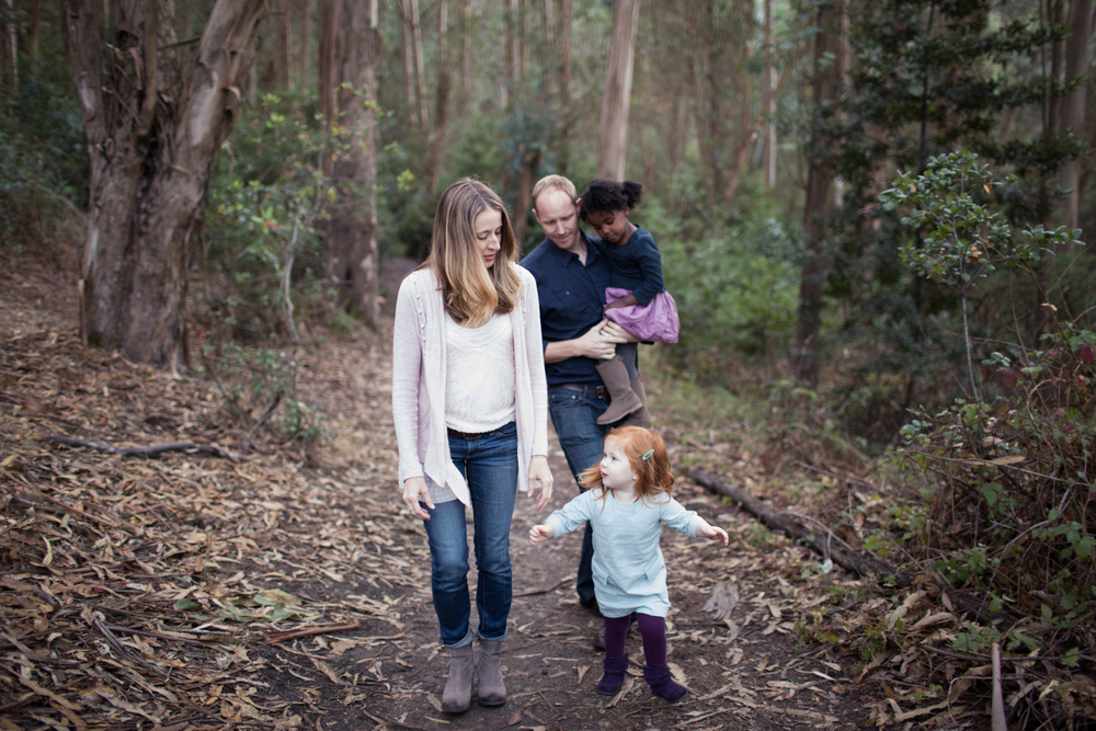 family walk through the woods