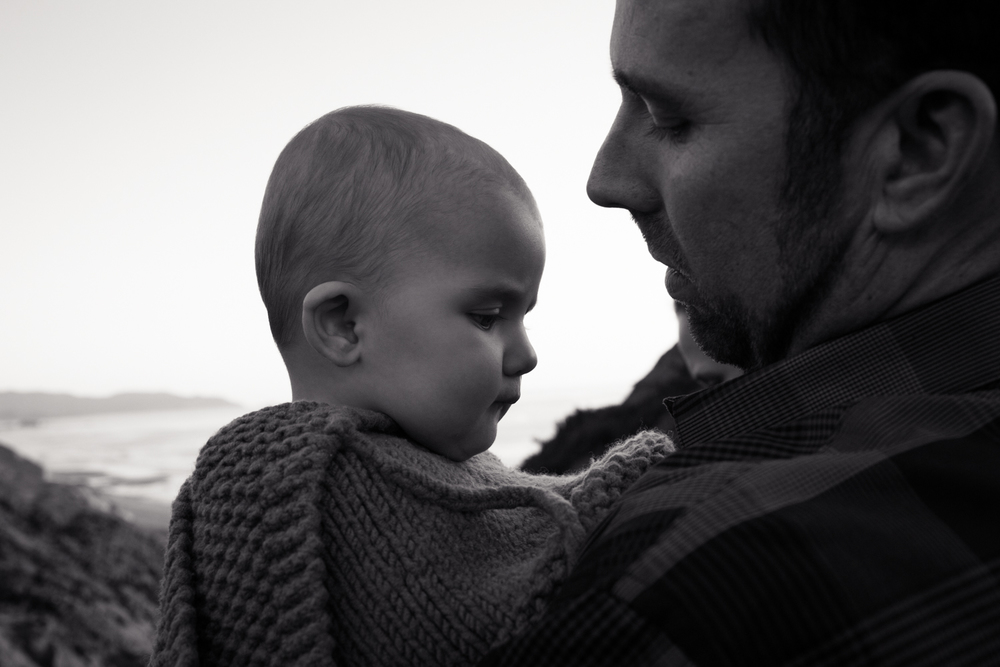 black and white with daddy at the beach