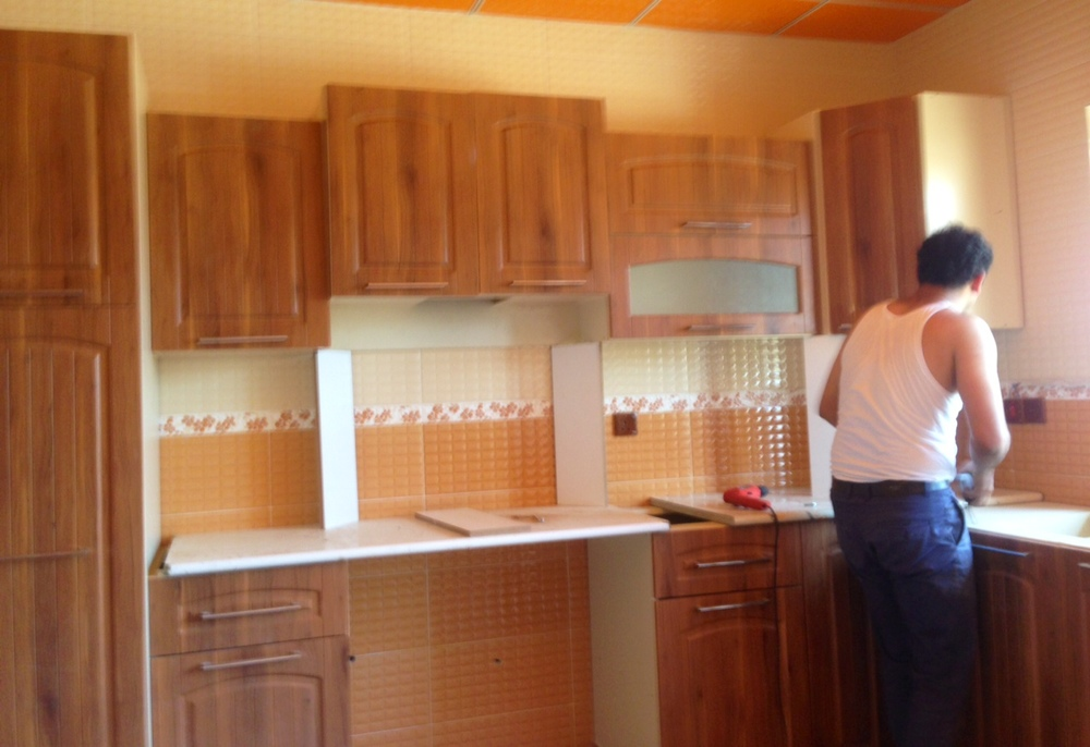 Installing the kitchen cabinets like a master cabinet maker!