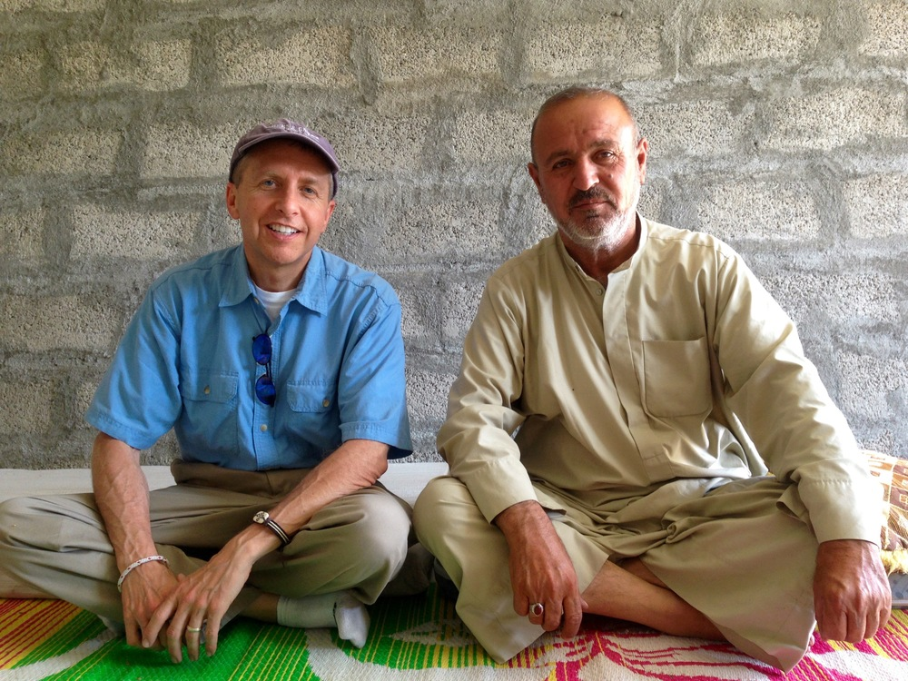 "Brian aka ""Abu William"" sitting with Abu Raheed of the Kawlokan Village."