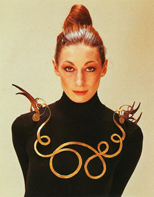 Anjelica  Huston wearing a Calder necklace in 1976 (The Jealous Husband made from  brass wire, c. 1940, collection Metropolitan Museum of Art). He often used humor in his art.
