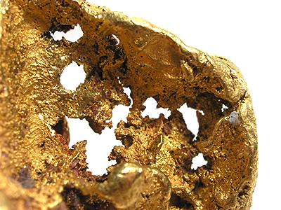 Gold from the Yuba River Placers area, Nevada County, California. Since it was unlikely to have been formed as a cast over another octahedral mineral, this specimen is believed to represent a rare phase and form in gold: octahedral hopper crystal growth.