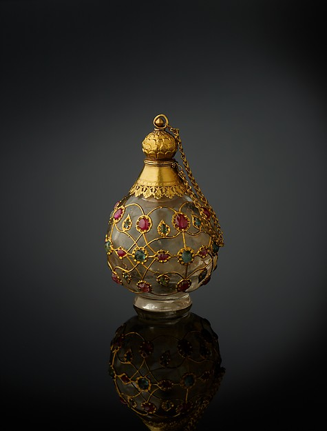 Source: The Met.   Date:1650–1700, North India.  Medium: Rock crystal, inlaid with gold wire, rubies, and emeralds, with gold collar, stopper, and foot.
