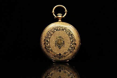 Antique 14K yellow gold and enamel pocket watch.  Source.