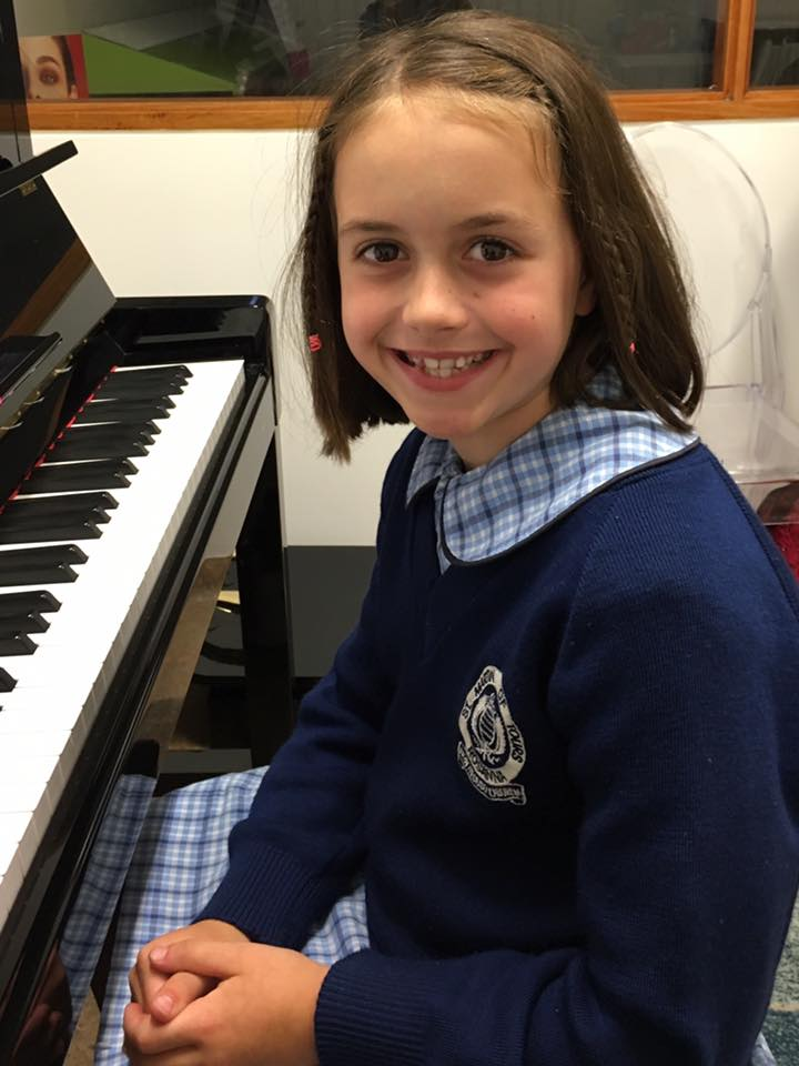 Hanna has been learning piano for two years!