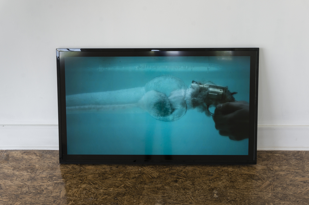Moving Study for The Introduction of a Vacuum into a Previously Emptied Space,  2014. guns, water, nonspace, video