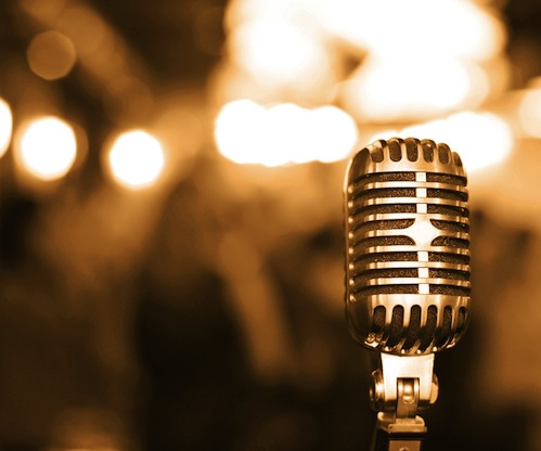 bigstock-Retro-microphone-on-stage-194588301.jpg