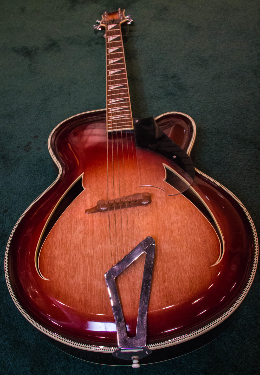 "This stunning archtop guitar was built by Rickenbacker's visionary guitar maker, Roger Rossmeisl, in 1957. It is often referred to as the ""Jazz-Bo""."