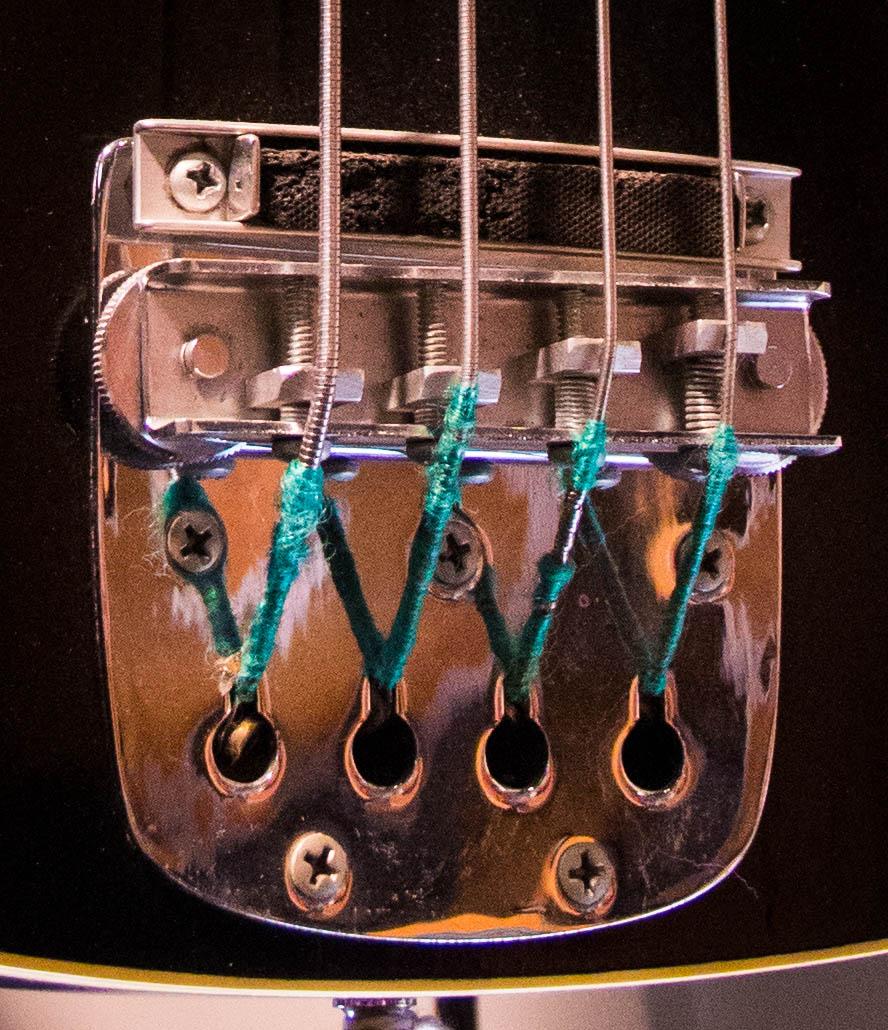 The odd bridge of the previous prototype bass.