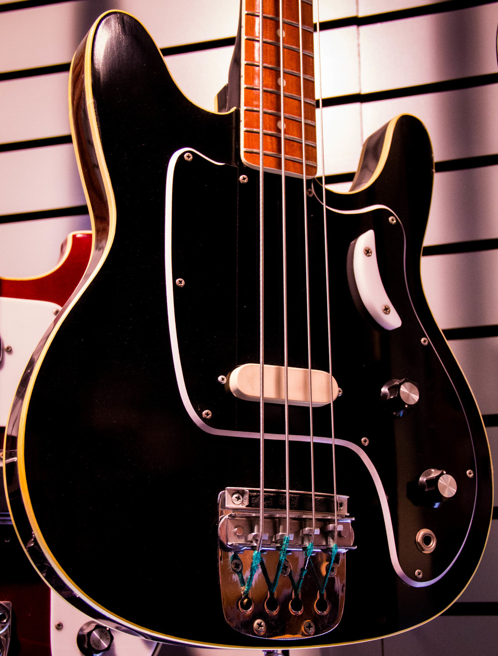 "A variation on the 3000-series basses, this example has a double-bound body and unique pickup, bridge, and ""tug-bar""."