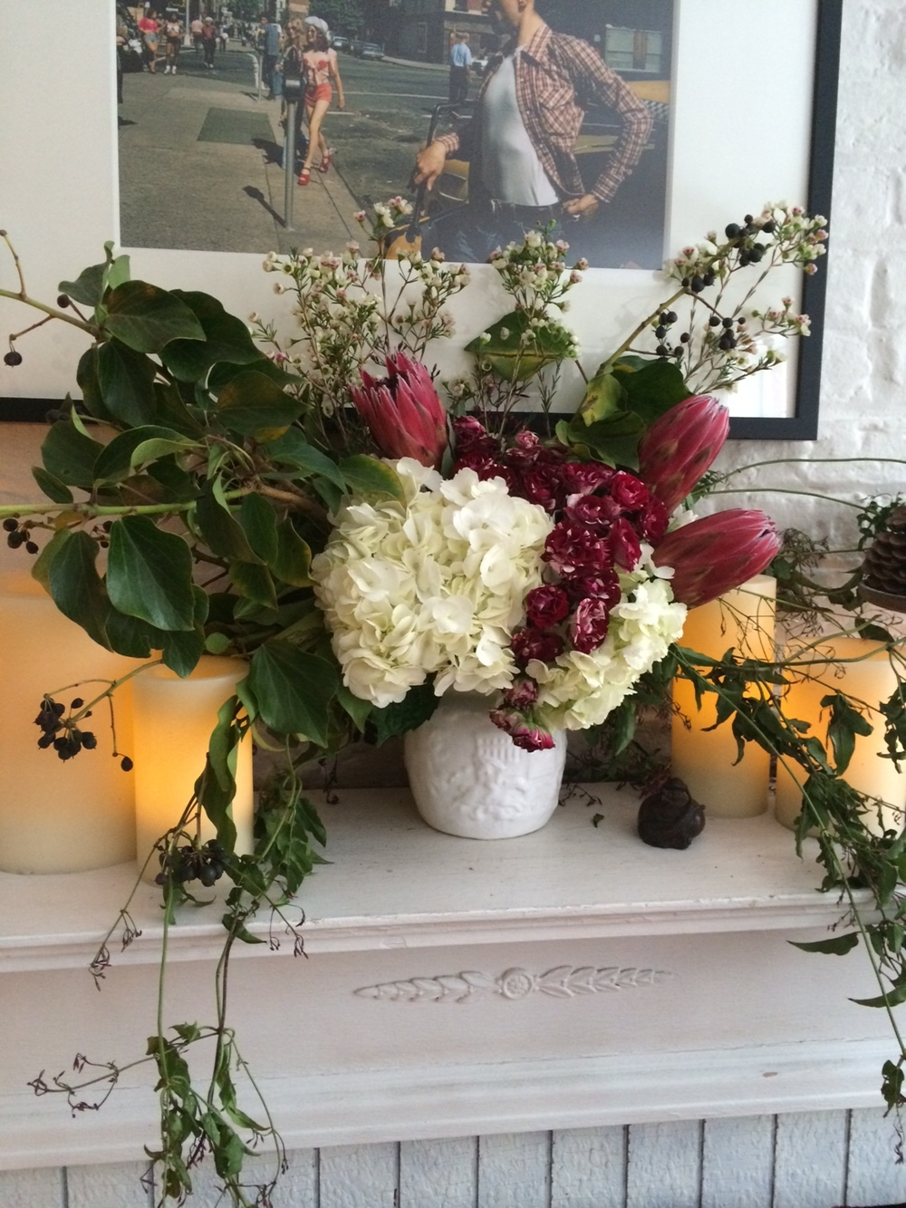 Hydrangea, Protea, Wax flower, Bush Ivy, Jasmine Vine, on mantelpiece