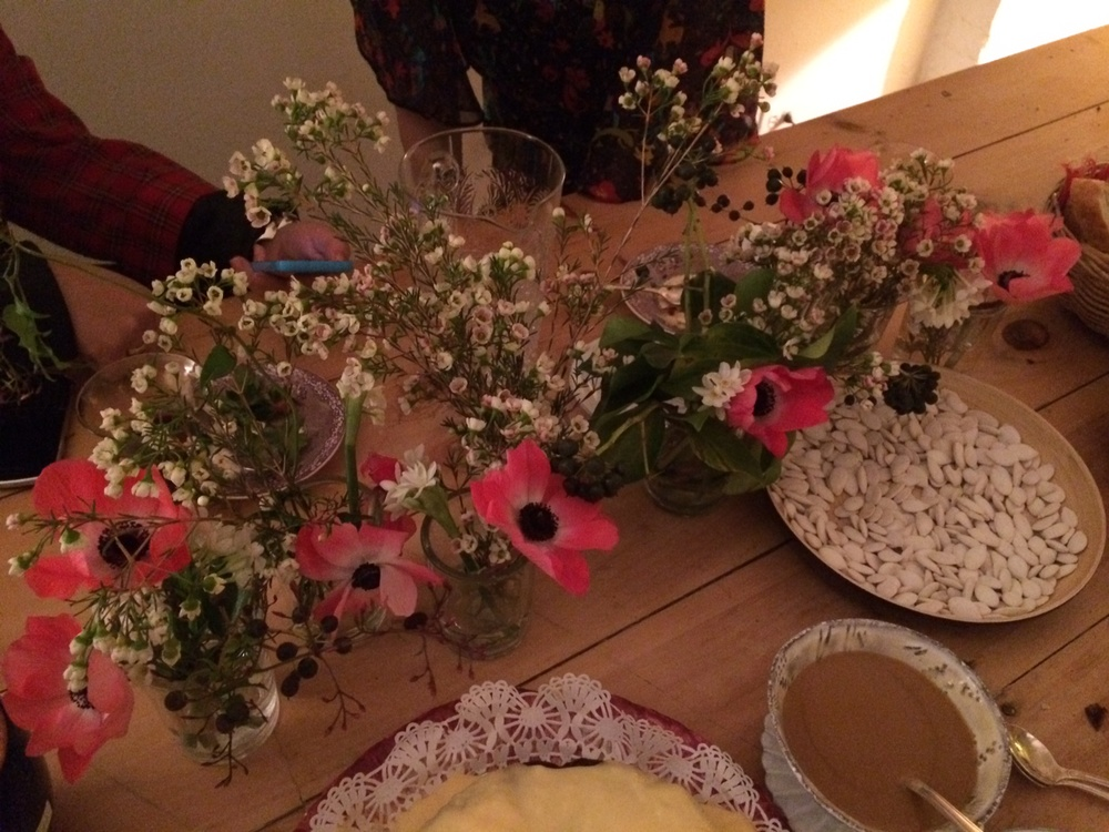 Small scattered arrangements for a delicate country table feel . Anemones, Wax Flowers, Bush Ivy.