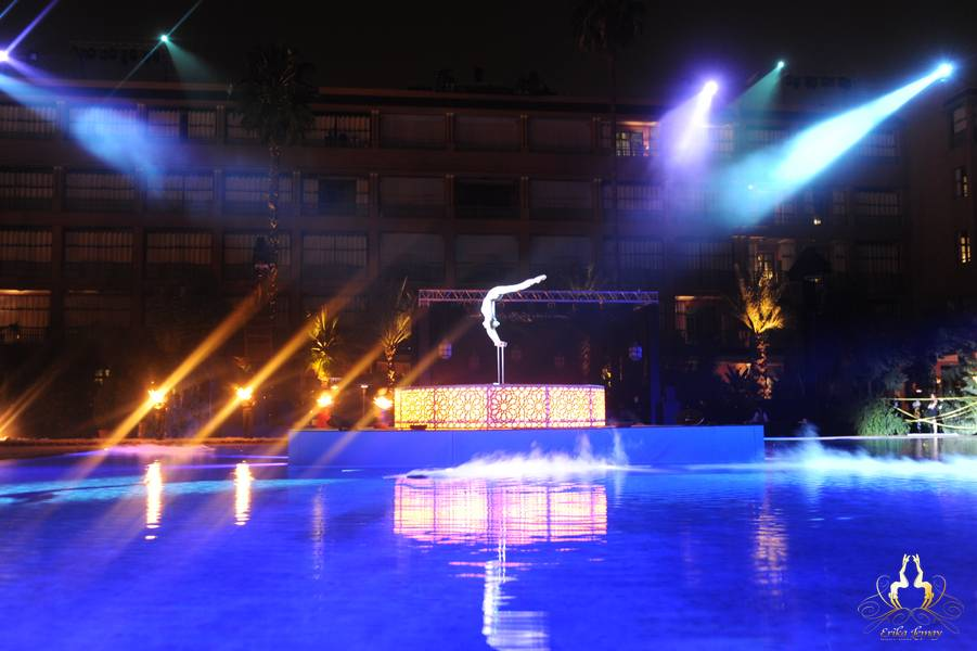 Erika Lemay performing on a stage set up in the middle of the pool