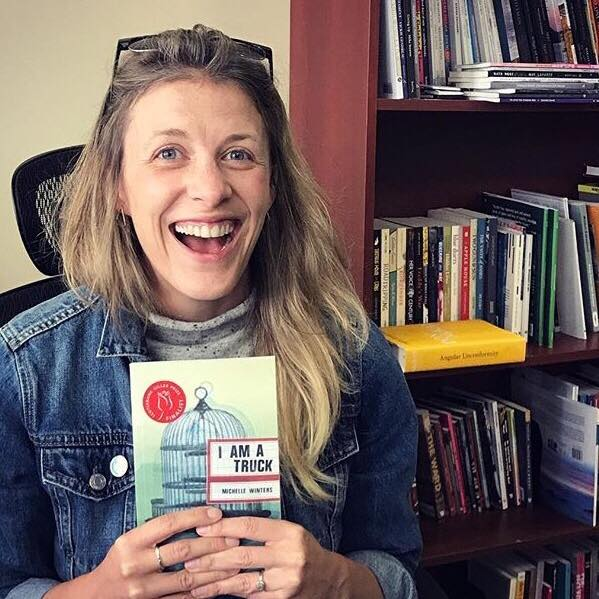 Leigh Nash, of Invisible Publishing, holding Michelle Winters' Giller short-listed I Am a Truck