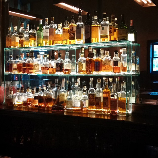A wall of glorious copper-colored liquid #eraserhood #whiskey #thetrestleinn