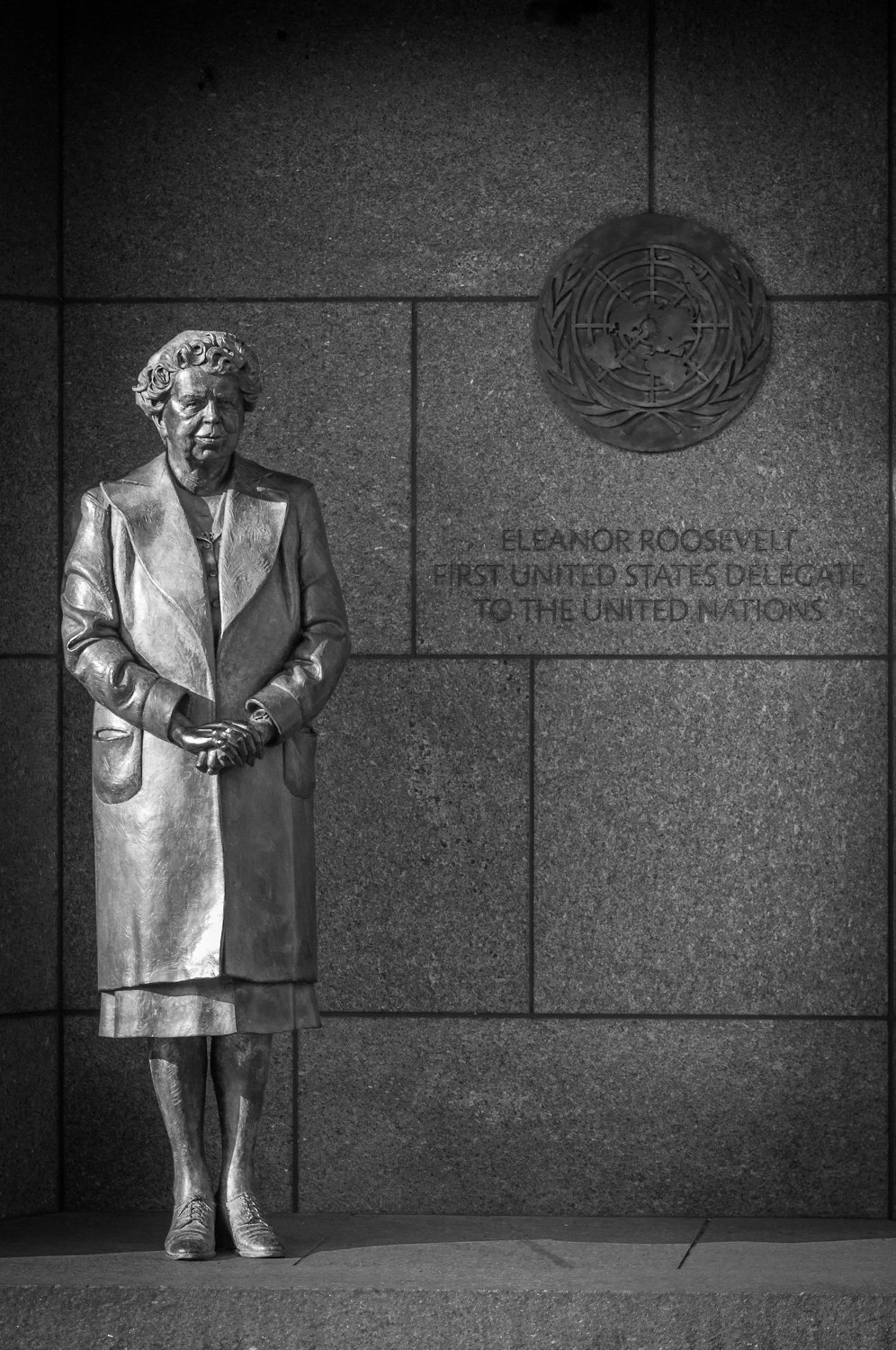 Black and white photo of statue of Eleanor Roosevelt in Franklin Delano Roosevelt Memorial.