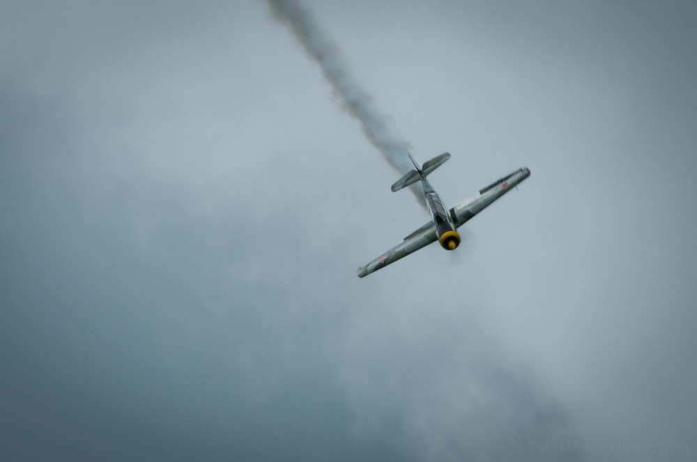 "Yak-52 Descent. Pilot: Charlie ""V+12"" VandenBossche. Camera settings: 360mm, 1/60 sec, f/45"
