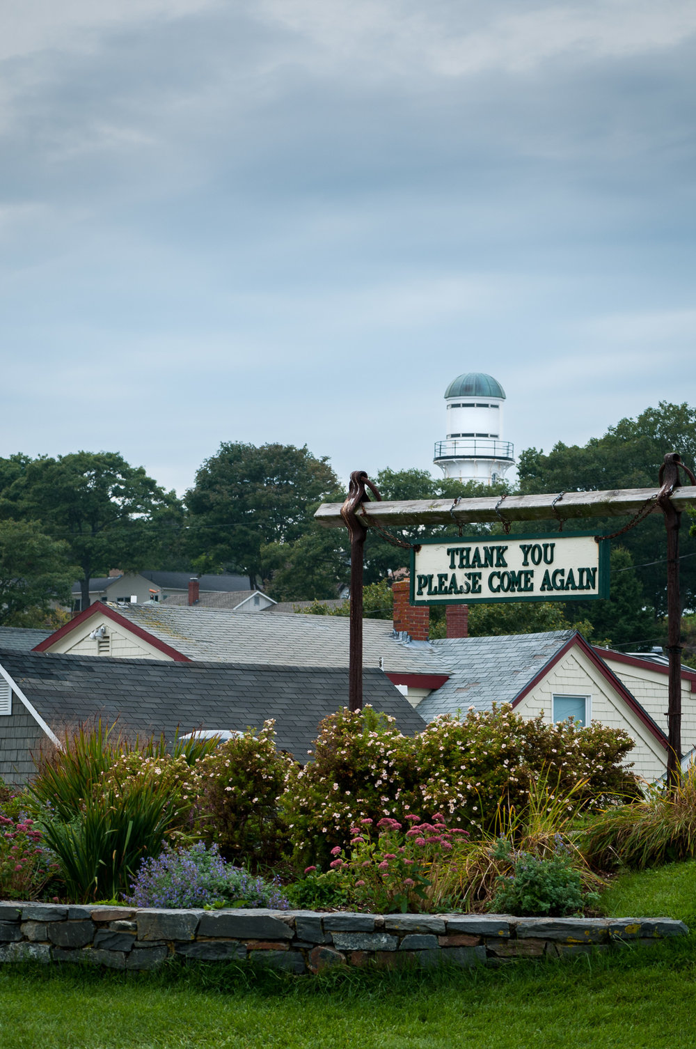 The Western Tower of Cape Elizabeth Light (Two Lights), in Maine, seen from the grounds of a restaurant