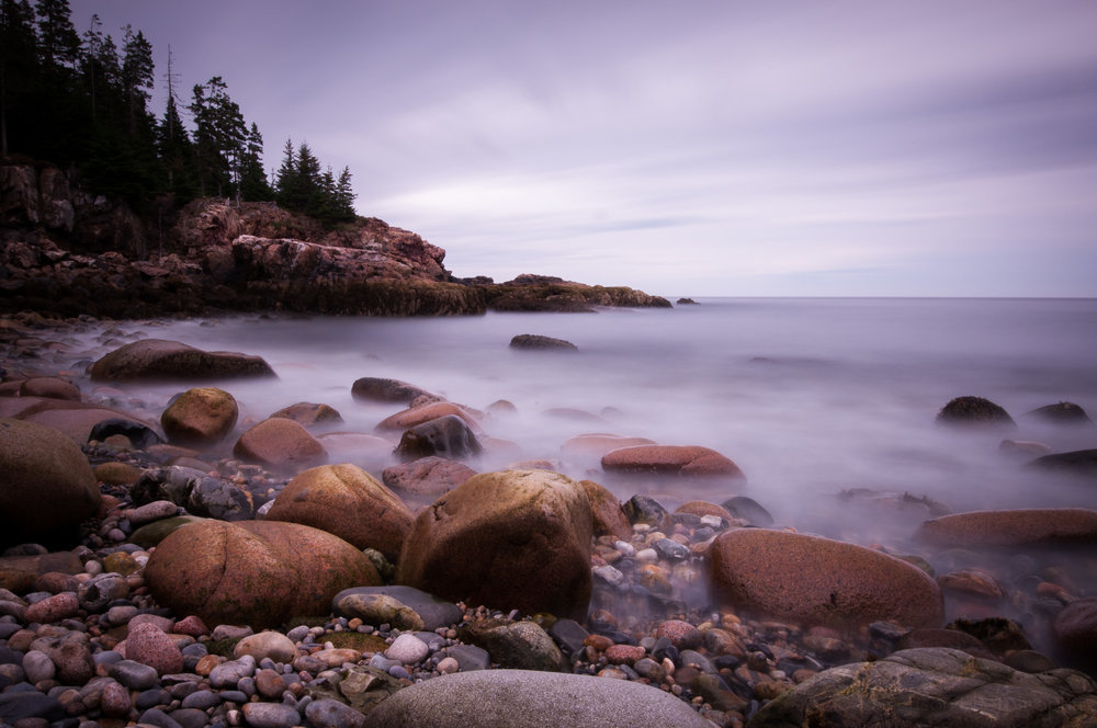 Long exposure of a rocky shoreline in Acadia National Park, Maine (warmer tones)