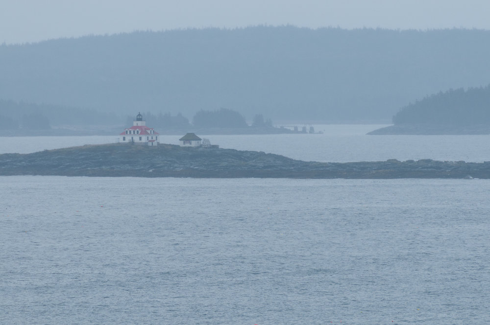 View of Egg Rock Light from parking lot of Schooner Head Overlook. This is an unprocessed image to show how hazy and rainy it was. (400mm focal length)