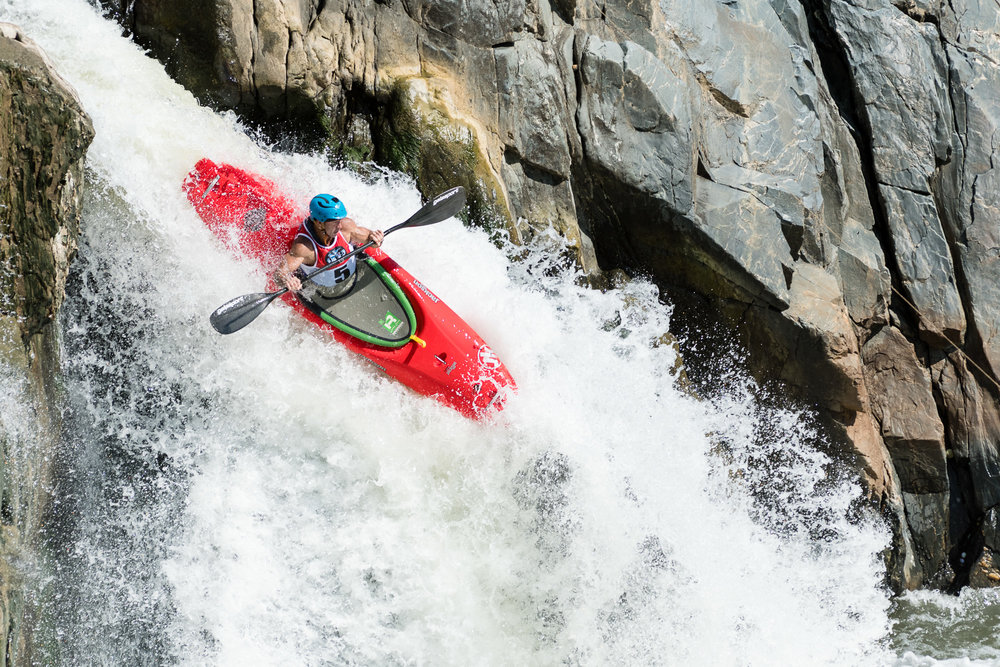 I love this image of Jason Beakes holding his paddle ready as he flies over The Crack.