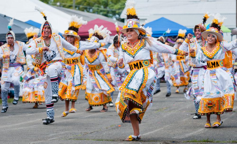 Fraternidad Alma Boliviana performing a Tinkus dance.