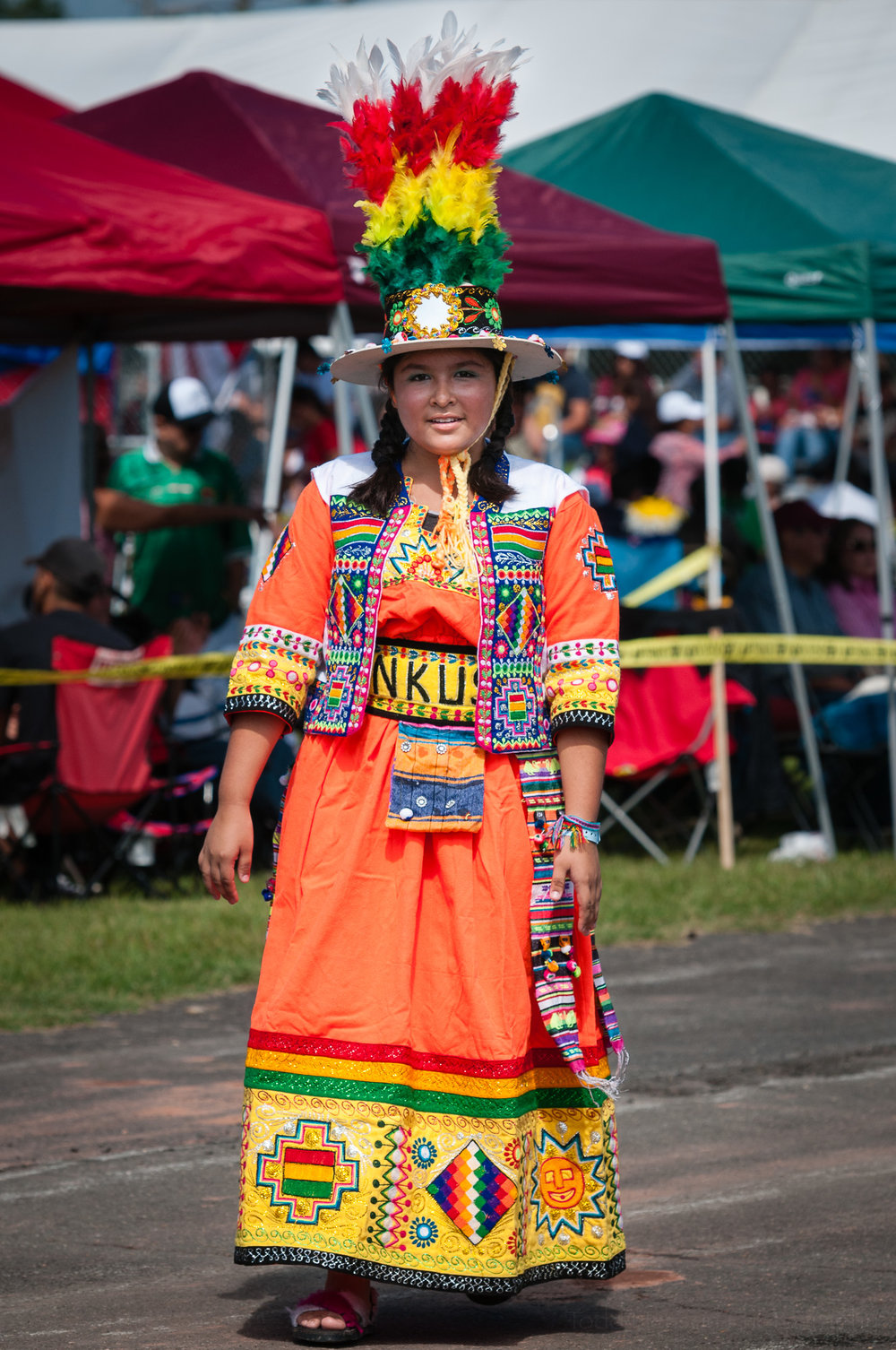 A member of Tinkus Bolivia, who performed a Tinkus dance. She saw me photographing and smiled for the camera.