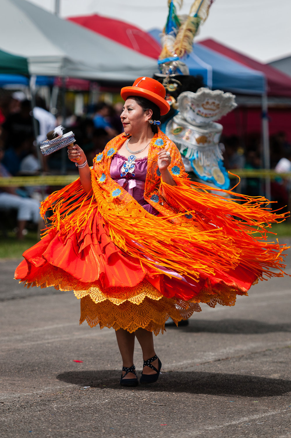 A performer from Embajadores del Folklore wore a beautiful flowing colorful dress while performing a Morenada dance.