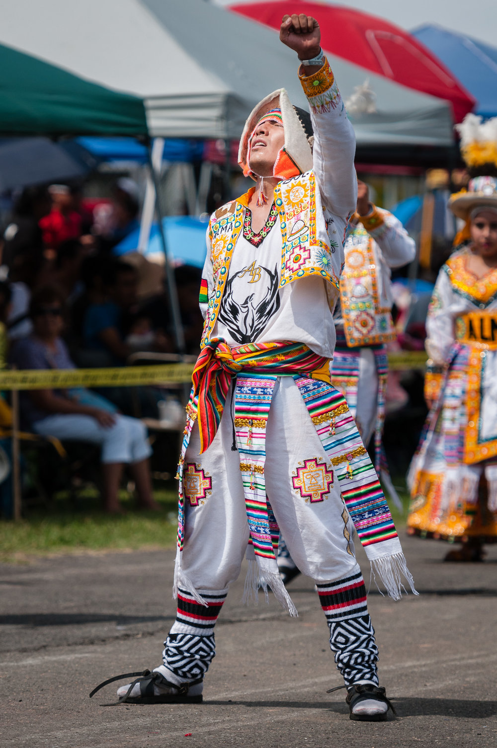 I love this pose from a member of Fraternidad Alma Boliviana during their performance of a Tinkus dance, raising his arm and lifting his head towards the sun.