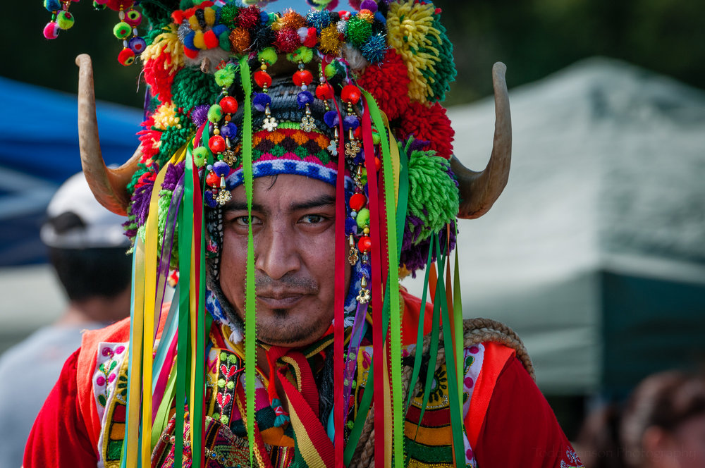 Here is an example of a performer looking right at the camera.  This performer was with Tinkus Bolivia who performed a Tinkus dance.