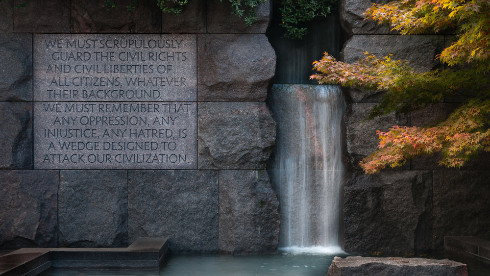 Part of the FDR Memorial showing a waterfall and quotation in autumn.
