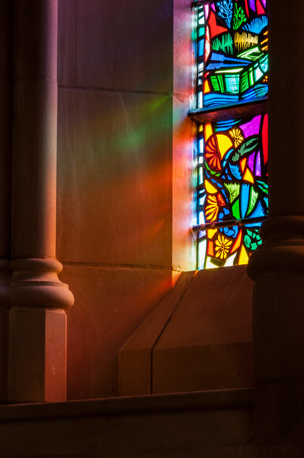 Light shining through a stained glass window.