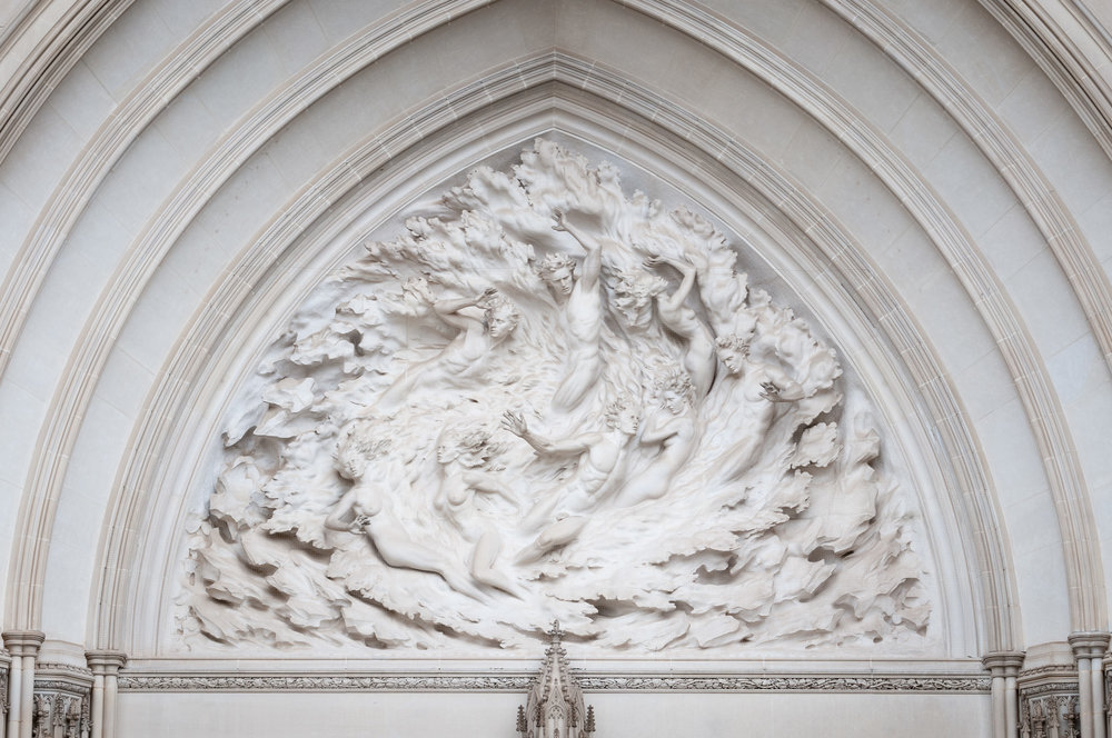 Ex Nihilo sculpture atop doors of Washington National Cathedral.