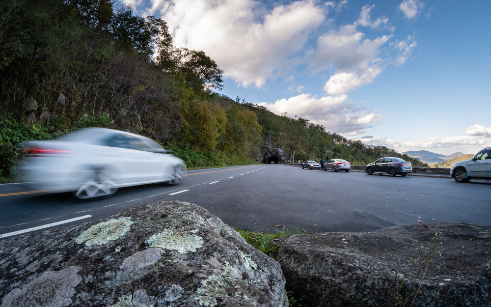 A car drives past, heading towards Mary's Rock Tunnel.