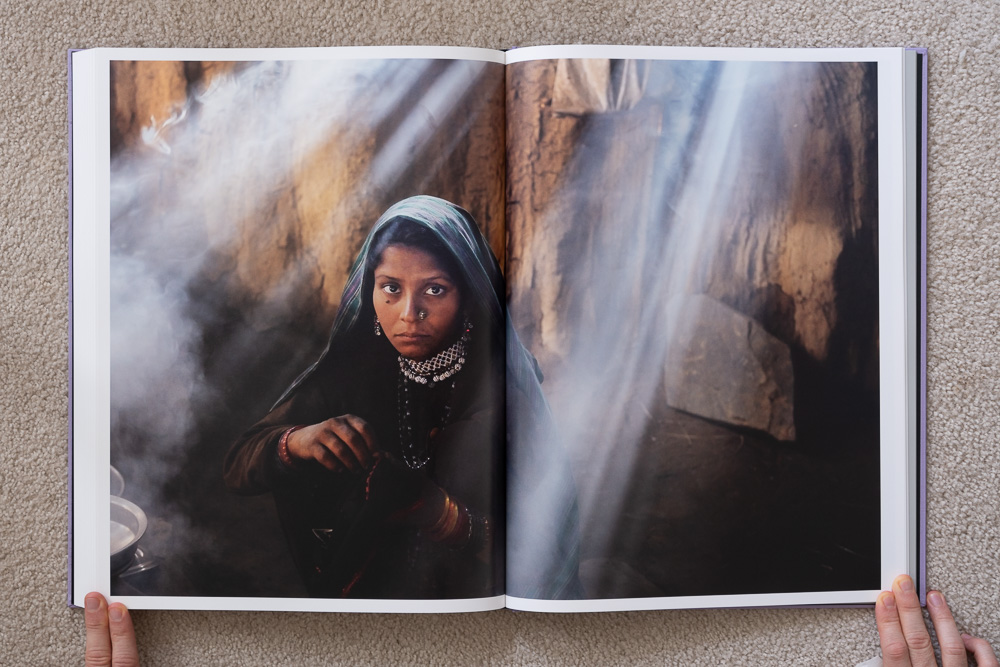 Steve McCurry: The Iconic Photographs . Girl Cooking, Uttarakhand, India, 2009.