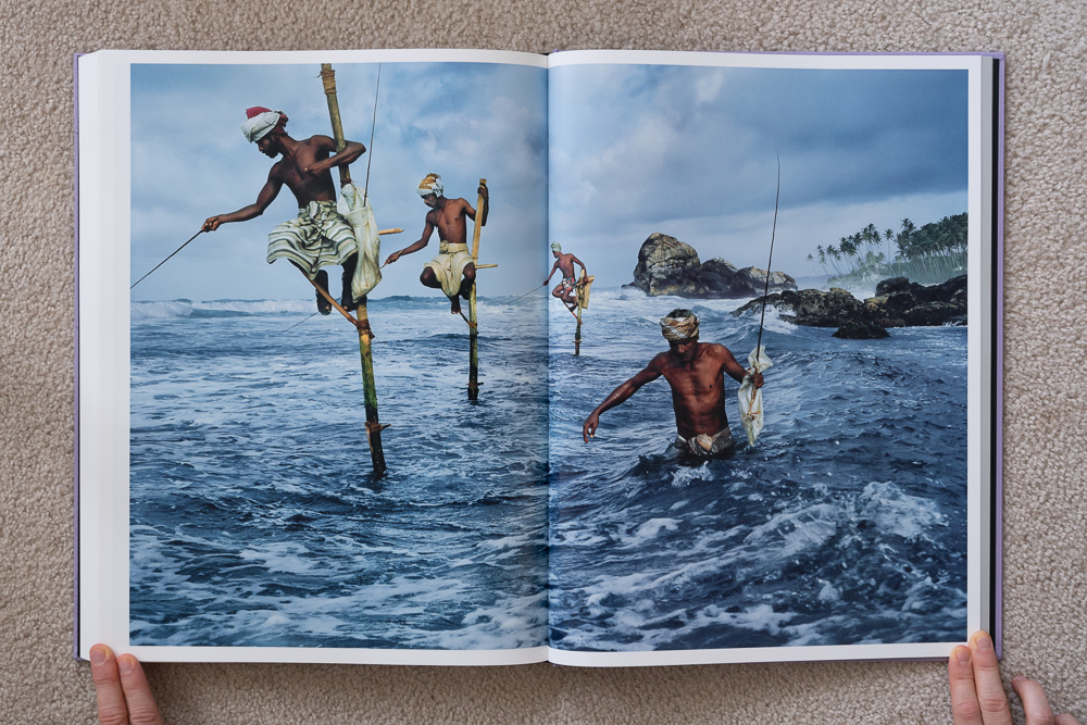 Steve McCurry: The Iconic Photographs . Stilt Fishermen, Weligama, Sri Lanka, 1995.