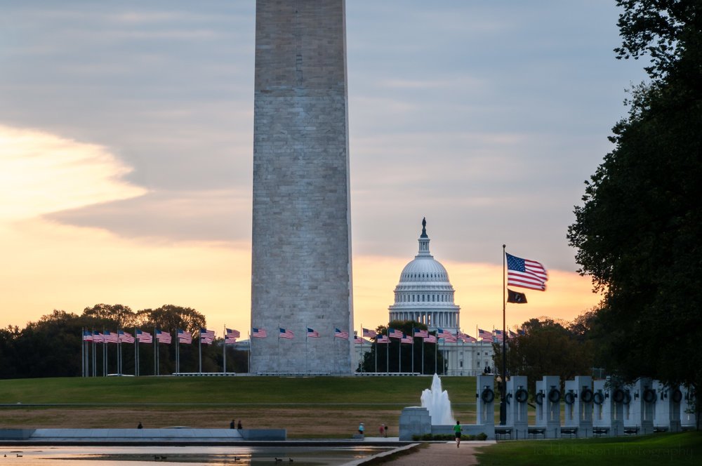 One Capitol Morning: National World War II Memorial, bottom portion of Washington Monument, and US Capitol, all lined up with flags waving. (5 image HDR)