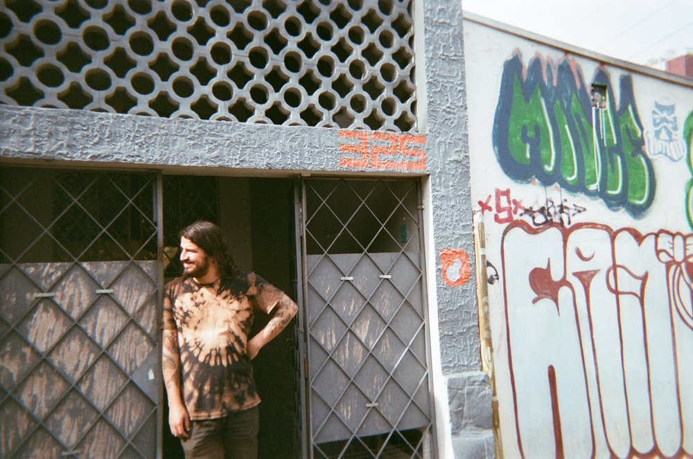 Xau in front of Lavanderia • Curitiba, Brazil  •  Photo by Kent Irwin